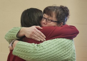 Gina Young, a member of Zion Iona and director of the Rainbow Ringers, says goodbye to Brigitte Schaefer during a farewell gathering at the church Jan. 5. Photo by Kathy L. Gilbert, UMNS.