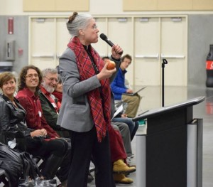 Rev. Richenda Fairhurst of Camas UMC testifies against the Tesoro Savage oil terminal while munching a Washington apple. Photo by Michele L. McDermid January 2016, used by permission.