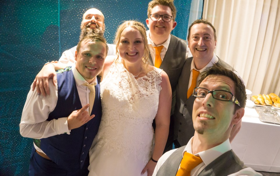The Pocket Rockers pose with the bride and groom at their wedding at Langstone Quays Resort.