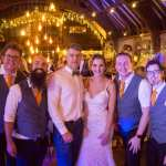 The Pocket Rockers pose with the bride and groom at their wedding at Dancing Man Brewery