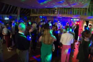 The dancefloor is full with people dancing at The Great Barn in Titchfield. The Pocket Rockers are performing at a Jess and Adam's Wedding.