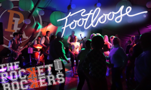 Thumbnail for the Live music video Footloose performed by The Pocket Rockers