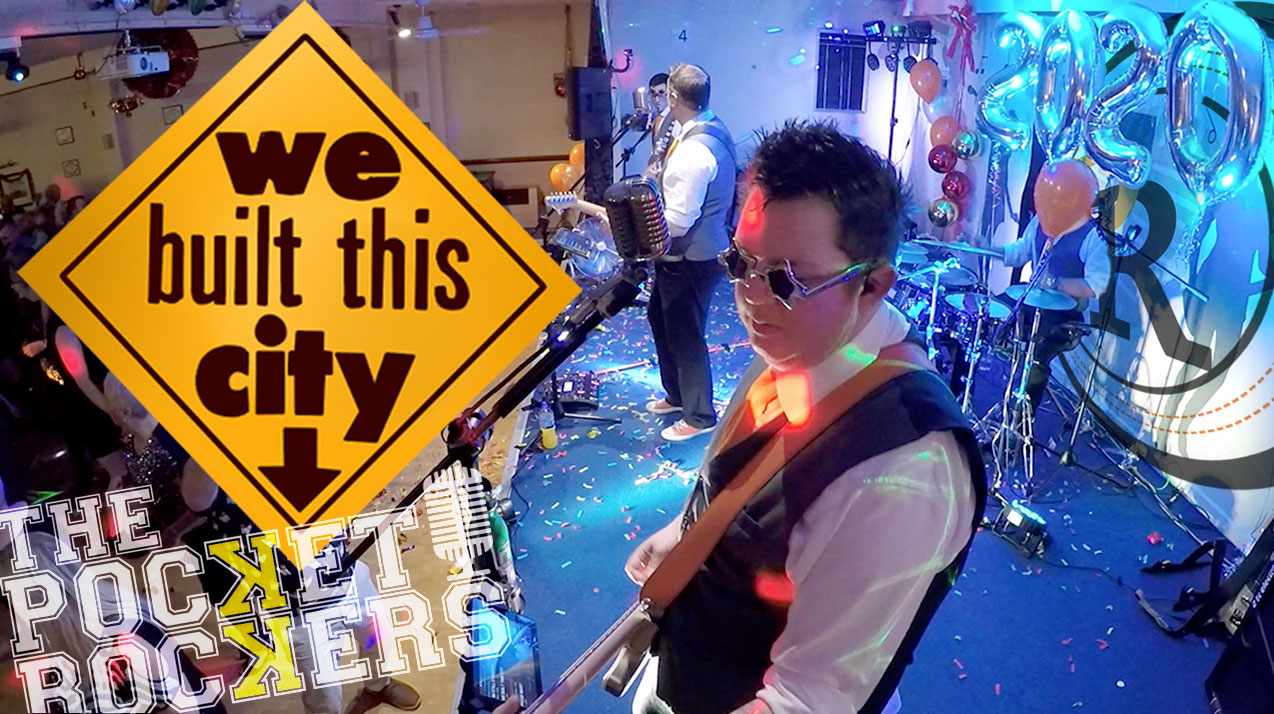 Thumbnail for the music video We Built This City performed by The Pocket Rockers