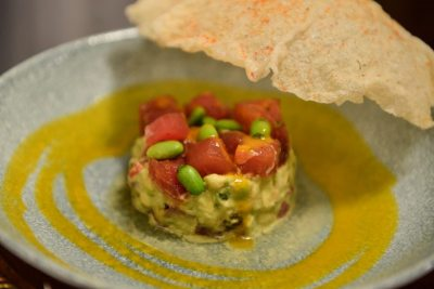 Tuna tar tar with edamame, avocado and mango sauce with a cracker dome