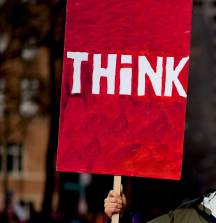 Photo of a poster saying 'Think'