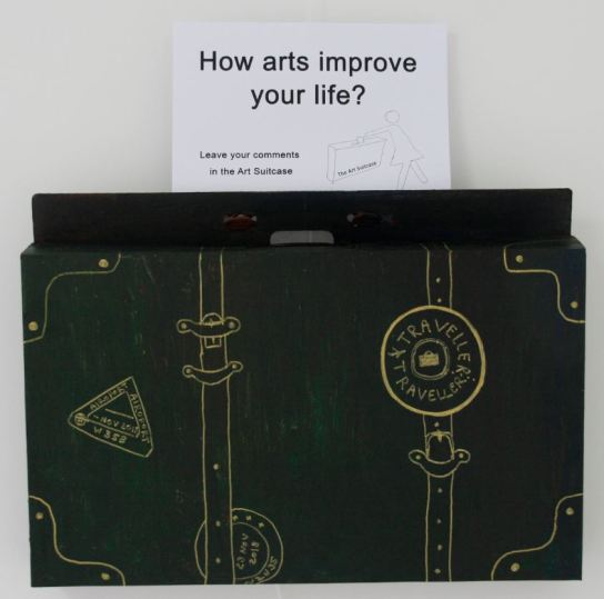 "We wish people to answer the question ""How can arts improve your life"" and put the notes in the suitcase."