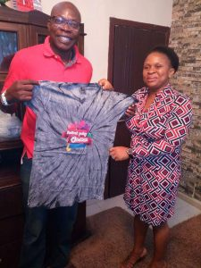 Ken Egbas, a former Commissioner of Cross River State being presented a Festival Poetry Calabar T-shirt by Ekaete George, Secretary of the Festival Poetry Foundation