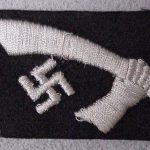 "13. Gebirgs Division der SS ""Handschar"" Collar Tab. A Nazi swastika with a hand holding an Ottoman Turkish dagger, a handzar."