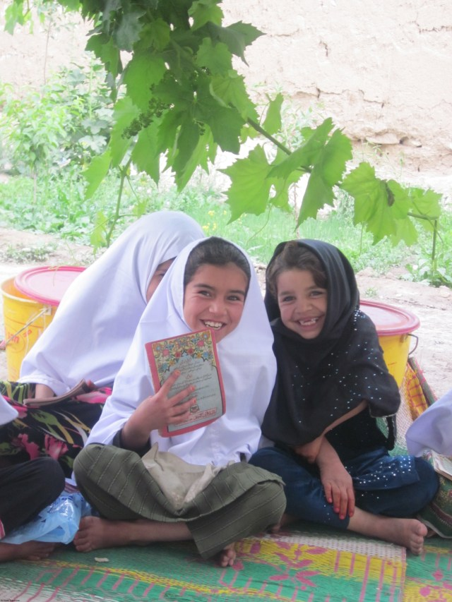 Two adorable girls having fun while learning