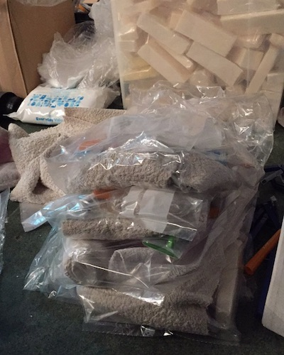 Hygiene kits for Calais Jungle refugees, containing soap, toothbrush, toothpaste, and a towel