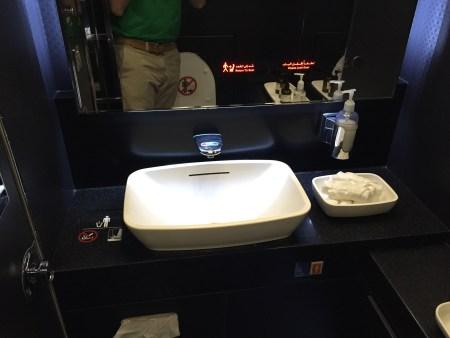 etihad first class 777 washington dc abu dhabi iad auh flight review seat wifi bathroom