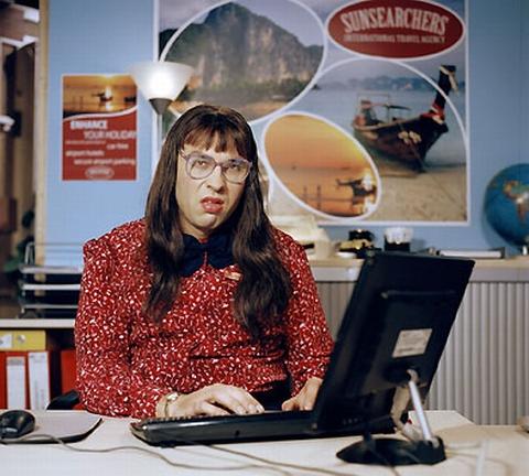 Grumpy rude receptionist Carol Beer of Sunsearchers on Little Britain