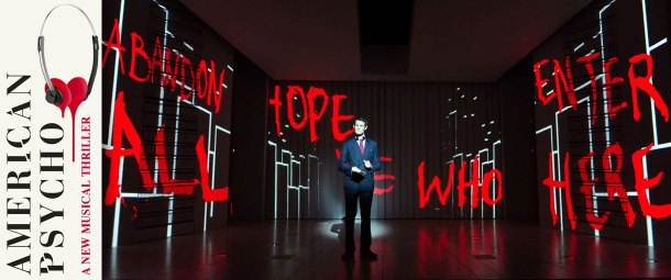 "A scene from American Psycho the musical at the Almeida Theatre. The image shows Matt Smith in the lead role of Patrick Bateman at the centre of an empty stage. Onto the set walls a simplified city skyline is projected in white light and also projected are the words ""Abandon all hope those who enter here"" that appear in a bright blood red."