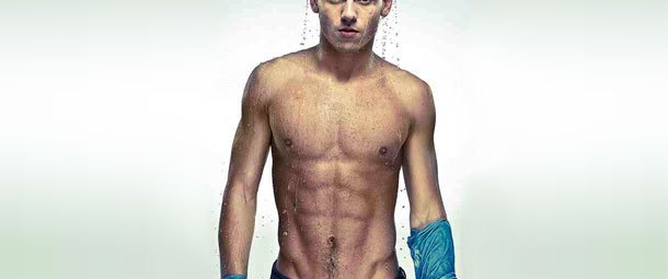 An image of diver Tom Daley with no shirt on standing dripping wet