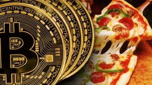 bitcoin pizza 300x169 - BITCOIN: A moeda do futuro virou realidade no presente - Por Anderson Costa