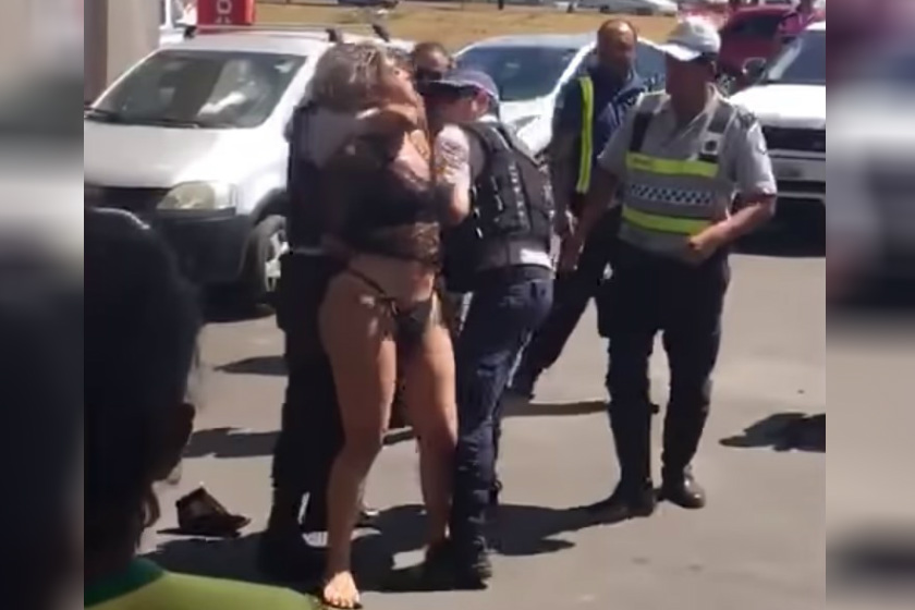VEJA VÍDEOS: Travesti é flagrada destruindo carro de luxo, causa confusão e é presa