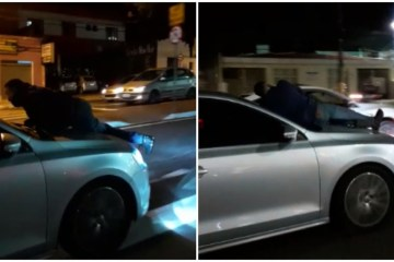 carro capo 6 - PERIGO! Homem é flagrado no capô de carro em movimento em avenida