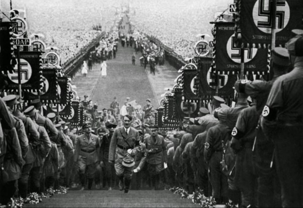 hitler-walking-up-steps-at-nazi-rally