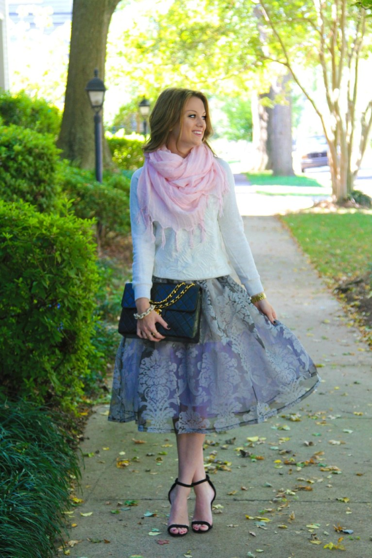 This is probably one of my most feminine looks. The skirt is so girly and I just loved pairing it with an unexpected sweatshirt!