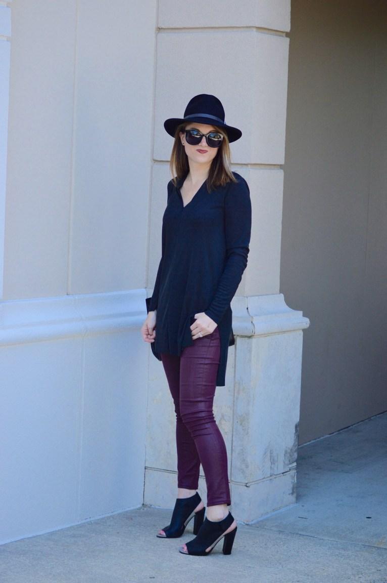 black tunic and black felt hat