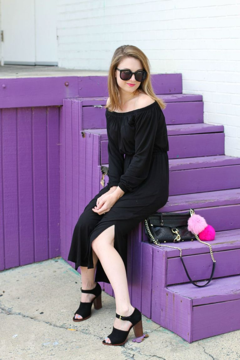 black off the shoulder midi dress and black bag with poof charms