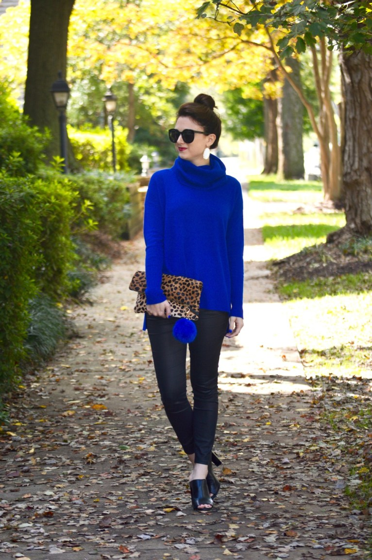 blue turtleneck sweater and coated denim and black mules