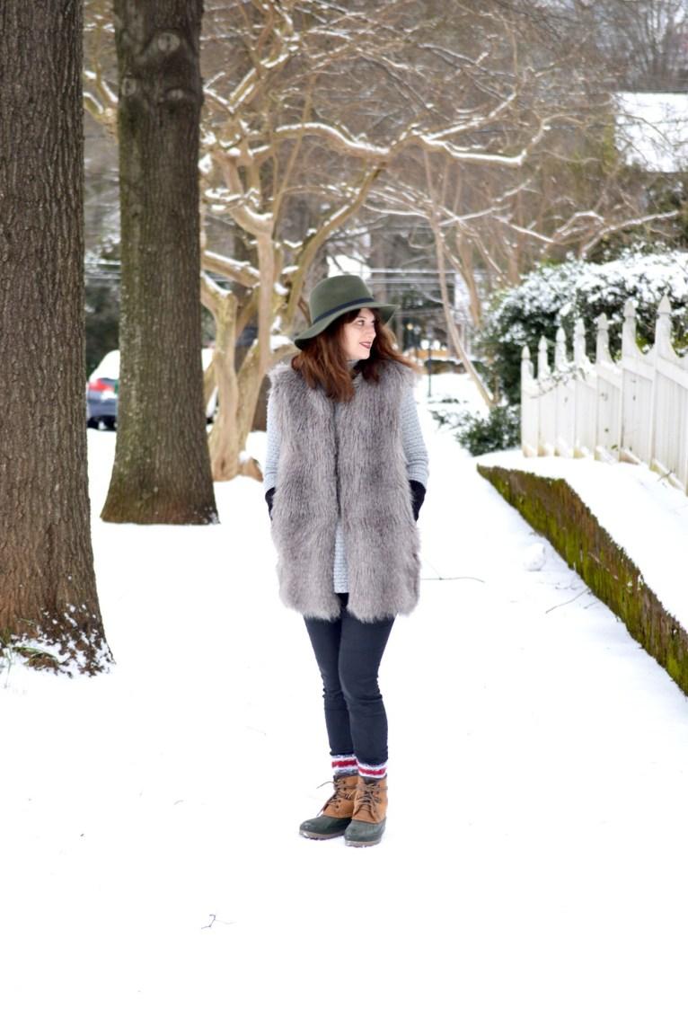 faux fur vest and snow boots