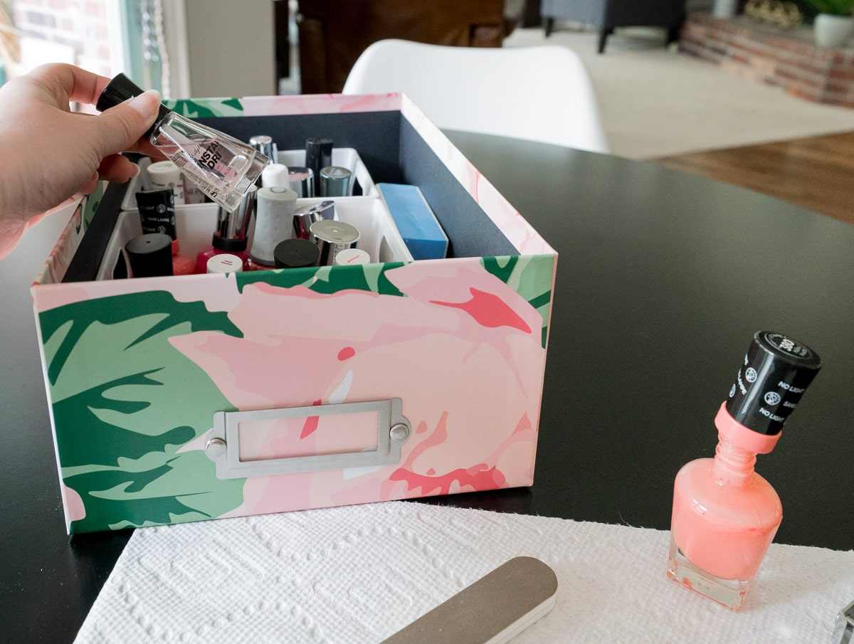 Pretty floral storage box containing nail polish / manicure supplies.