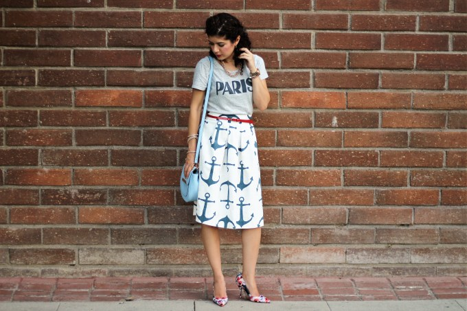 Anchor print skirt and graphic tee with floral print shoes for an unexpected pattern mixing outfit