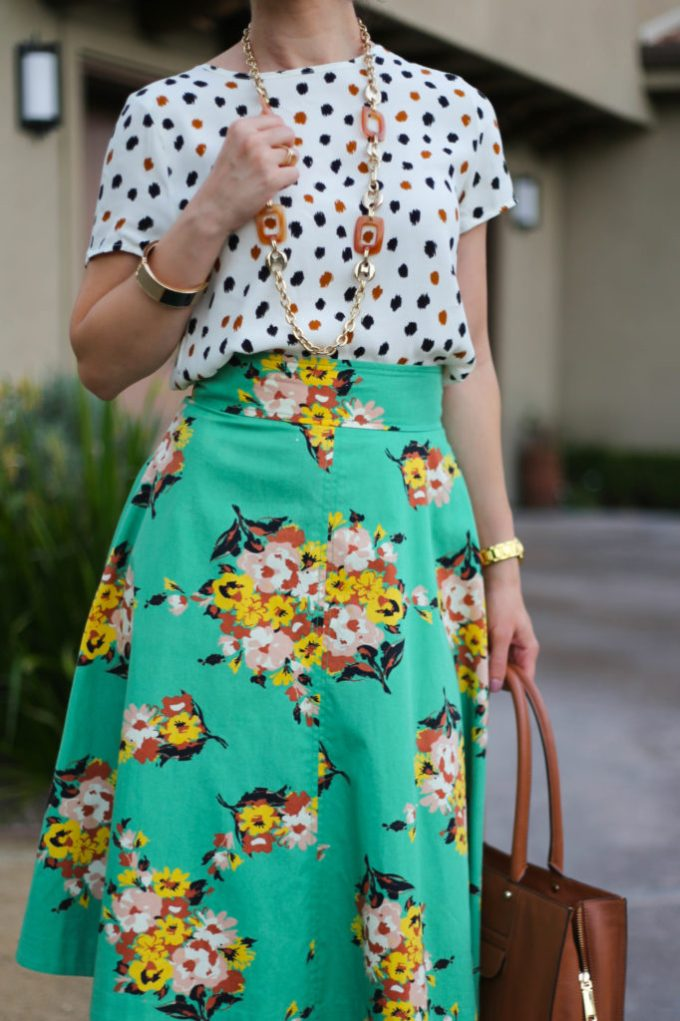 Everyday style blogger polished whimsy wears a triple pattern mix outfit with green floral Anthropologie midi skirt neutral polka dot shirt and leopard print heels