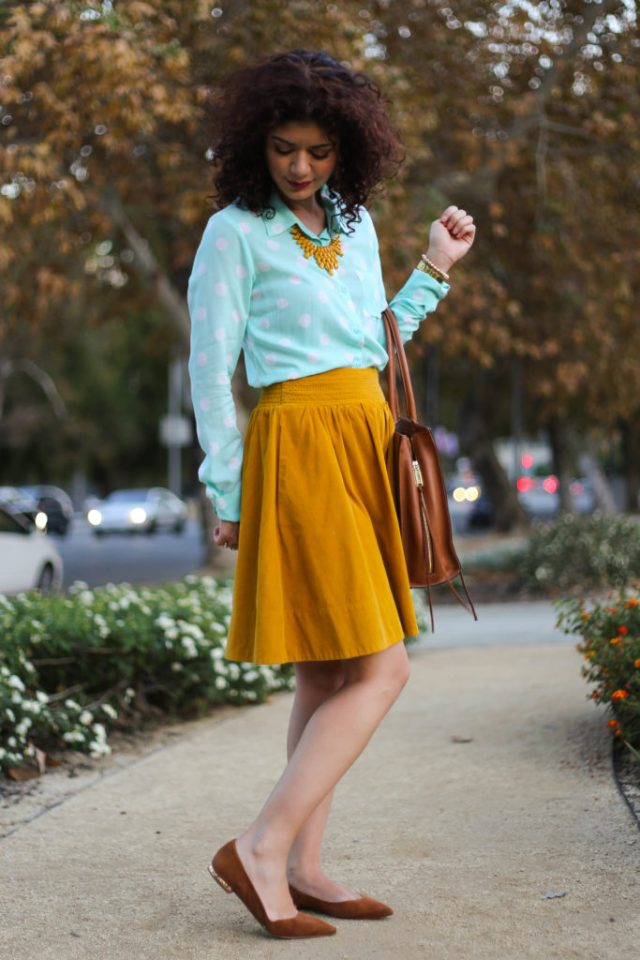 Mint and mustard outfit with anthropologie corduroy skirt demonstrating 2017 fall fashion trends