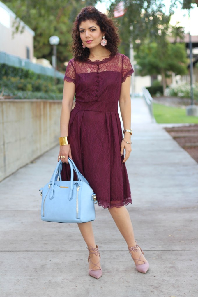 Polished whimsy in baby blue bag and burgundy dress