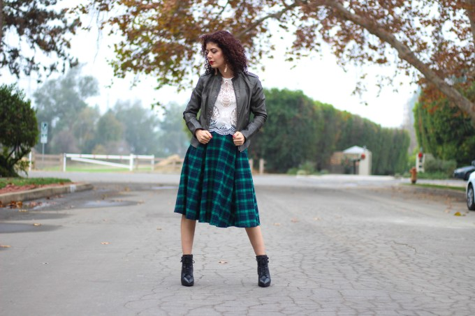 polished whimsy in green tartan skirt with lace top and leather jacket