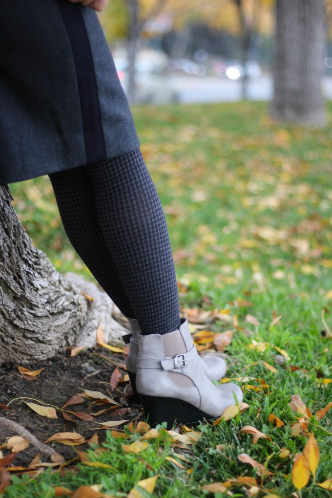 Polished whimsy in herringbone tights and wedge booties