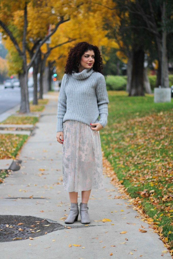 Polished whimsy in skirt and turtleneck sweater with wedge booties