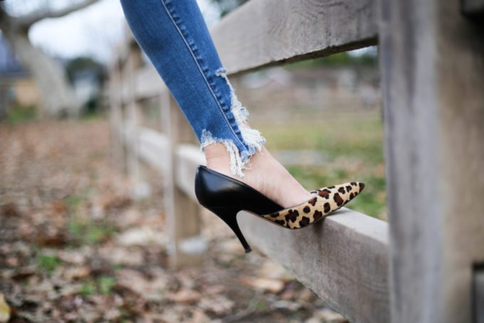 Polished whimsy in distressed jeans and leopard print shoes