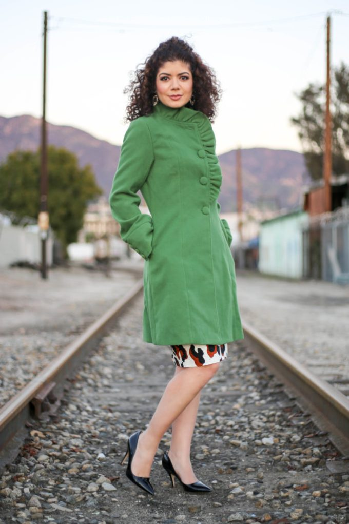 polished whimsy in green ruffle coat