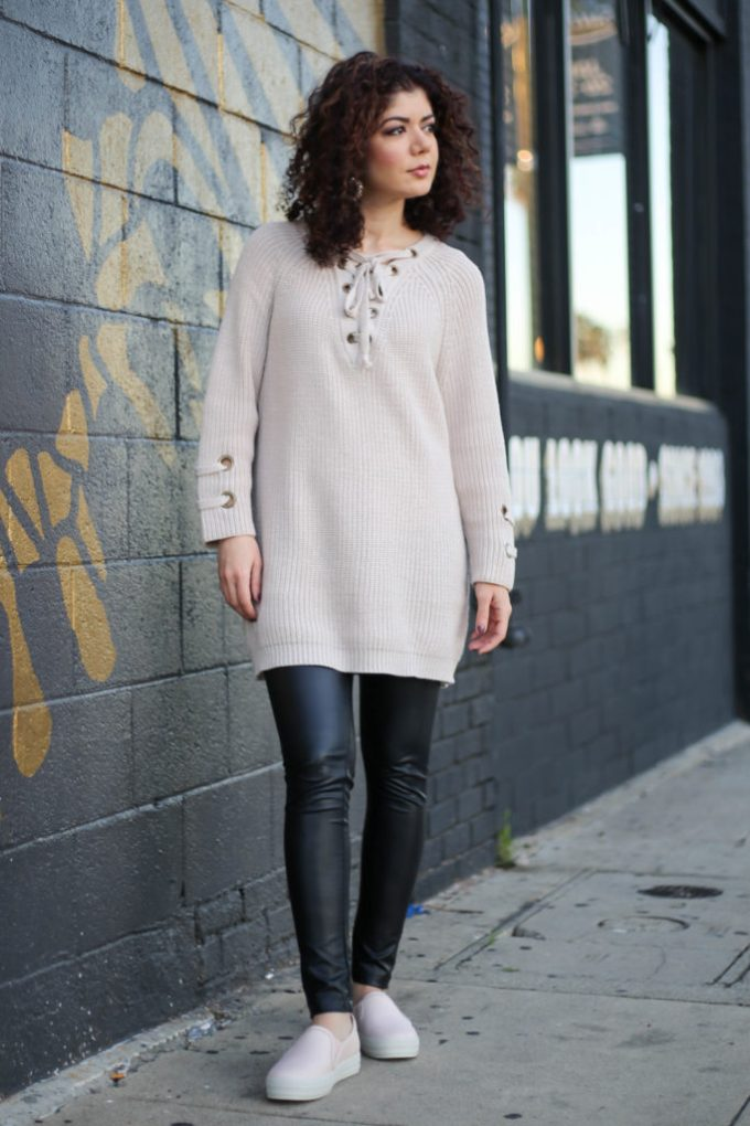Polished whimsy in leather leggings and blush lace-up sweater