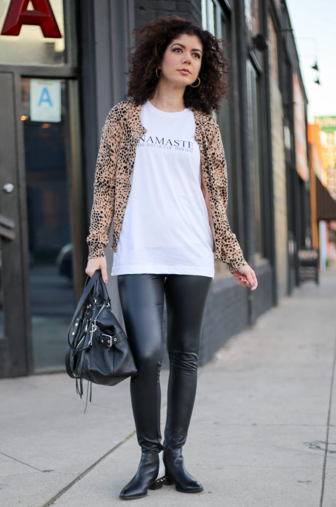 Polished whimsy in leather leggings, graphic tee and cheetah print cardigan