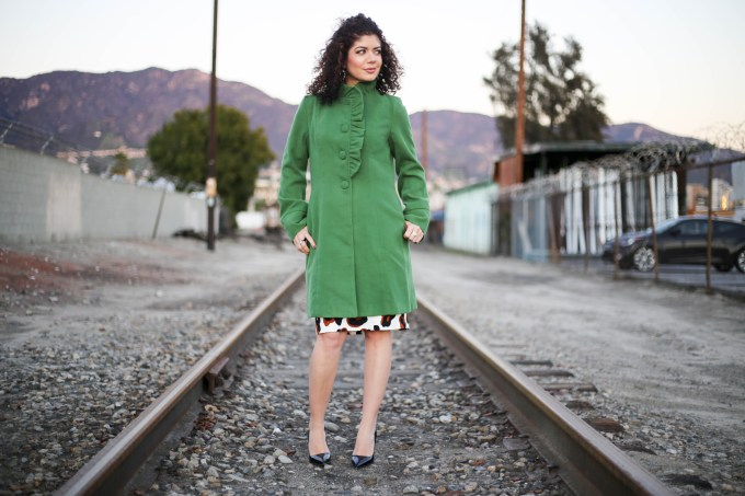 Polished whimsy in green colorful coat