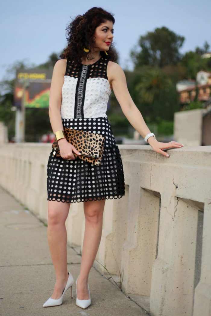Everyday style blogger polished whimsy wearing devlin color block eyelet lace dress, Clare V leopard print clutch, white Sam Edelman pumps and baublebar yellow earrings for spring transition outfit