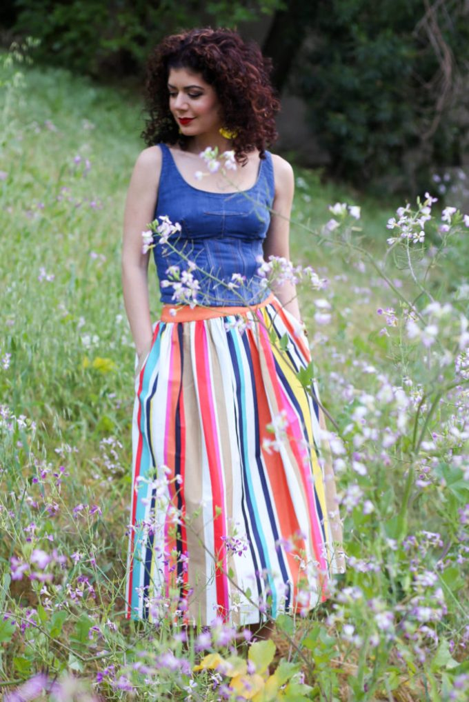 Colorful striped skirt styled for a special occasion with the Alice and Olivia Nicola skirt and Anthropologie denim corset cami