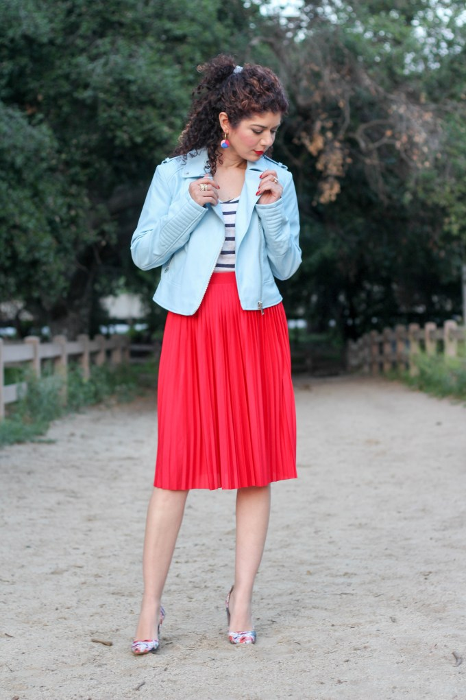 Baby blue and red color combination with a spring leather jacket and pleated skirt. Stripes and floral print for a pattern mixing outfit.