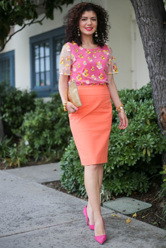 Pink and orange outfit with J crew orange pencil skirt, DVF pink top, Kate Spade pink shoes and J Crew gold clutch