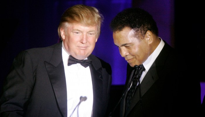 Donald Trump, left, accepts his Muhammad Ali award from Ali at Muhammad Ali's Celebrity Fight Night XIII in Phoenix, Ariz., Saturday, March 24, 2007. (AP Photo/Jeff Chiu)