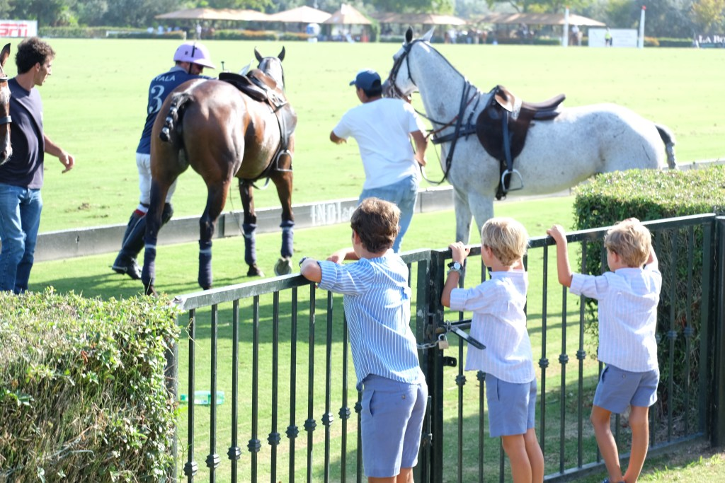 Facundo Pieres changing horses and a little fanclub ran down to get a closer look.