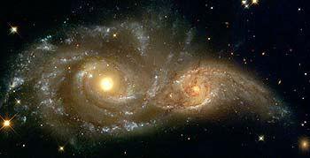 NGC 2207 e IC 2163