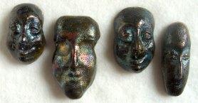 raku fired ceramic faces