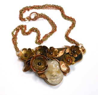 metal and ceramic flowers and face necklace