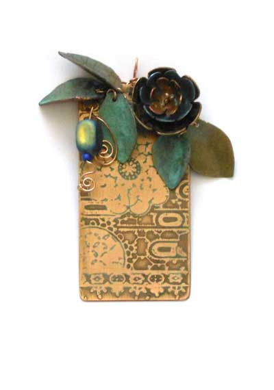 etched bronze and patina metal pendant